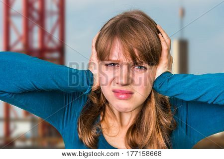 Woman Covering Her Ears To Protect From Loud Noise