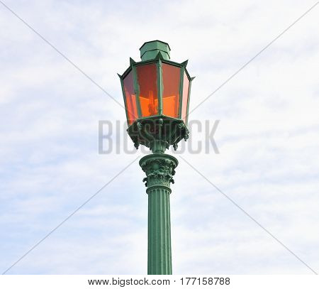 Street lamp in the old style on blue sky background in St.Petersburg Russia.