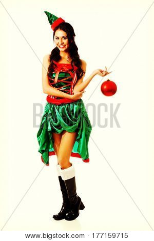 Woman hanging christmas bubble on her finger