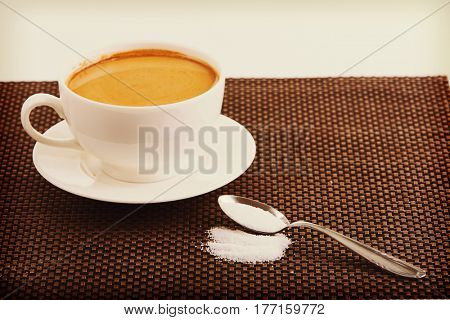 Coffee cup and suggar