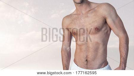 Digital composite of Fitness man torso against cloud background