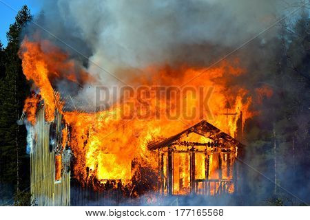House completely engulfed in flames. Horizontal image.