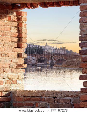 historical quarter of Verona, view on ponte Pietra bridge at sunset