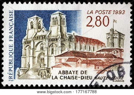 LUGA RUSSIA - FEBRUARY 7 2017: A stamp printed by FRANCE shows view of founded in the 11th Century Abbey of Chaise-Dieu in the Haute-Loire department in south-central France circa 1993