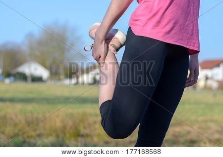 Woman Doing Stretching Exercise Before Jogging