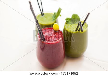 Healthy green and red smoothies - superfoods detox diet health vegetarian food concept