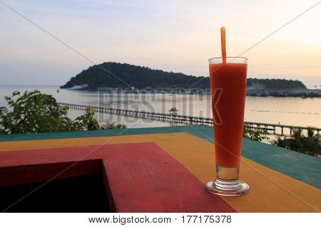 Travel to Island Koh Chang, Thailand. The papaya juce with view on the sunset beach.