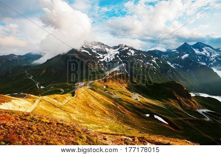 Impressive view of sunlit hills. Picturesque day gorgeous scene. Location place Grossglockner High Alpine Road, Austria. Europe. Outdoor activity. Drone photography. Explore the world's beauty.