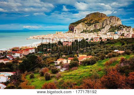 An impressive view of the famous resort Cefalu. Location place Tempio di Diana, Sicilia, Italy, Tyrrhenian sea, Europe. Wonderful day and gorgeous scene. Popular tourist attraction. World of beauty.