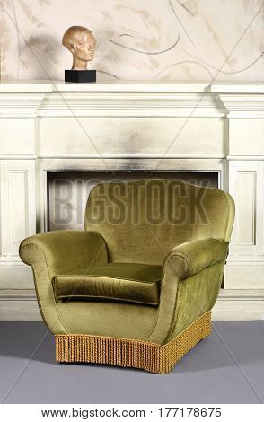 Retro Green Velvet Arm Chair In Front Of Fireplace
