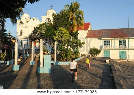 Flores, Guatemala - 15 January 2014: The colonial square and church at Flores on Guatemala