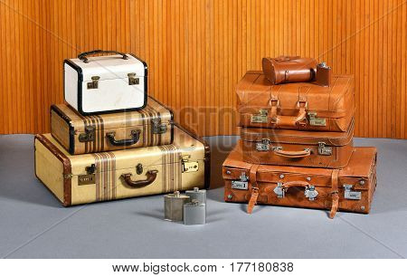 Stacks Of Antique Suitcases And Drinking Flasks