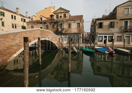 CHIOGGIA, ITALY - MARCH 19, 2017: Abandoned renaissance building in old city of Chioggia, Italy