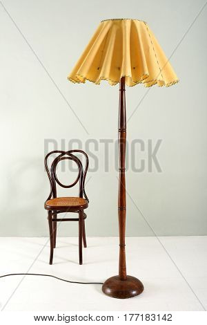 Wood Floor Lamp With Ruffled Shade And Small Chair