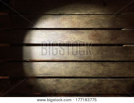 Lighting wood board in darkness use for background.