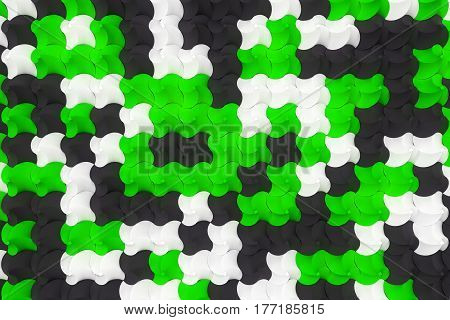 Pattern Of Black, White And Green Twisted Pyramid Shapes