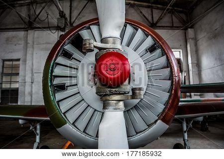 Sport plane propeller close-up in a dark hangar