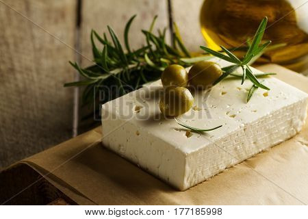 Fresh tasty greek green olives with cheese feta or goat cheese. Closeup. Mediterranean food.