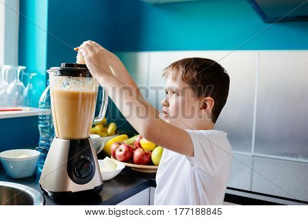 Happy Little Boy Is Making Healthy Fruit Juice At Home