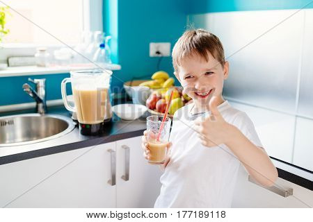 Happy Little Boy Is Drinking Selfmade Fruit Cocktail