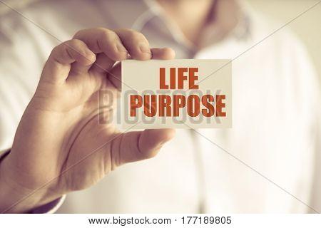 Businessman Holding Life Purpose Message Card