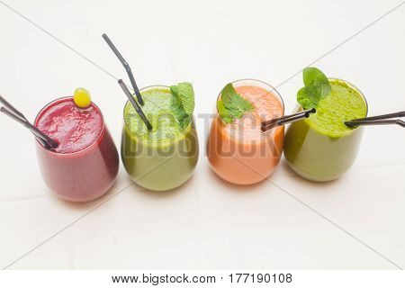 Red and green healthy smoothies on table