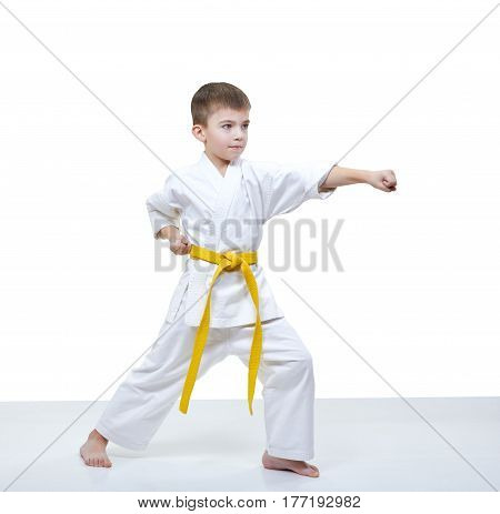 Boy with yellow belt beats punch arm