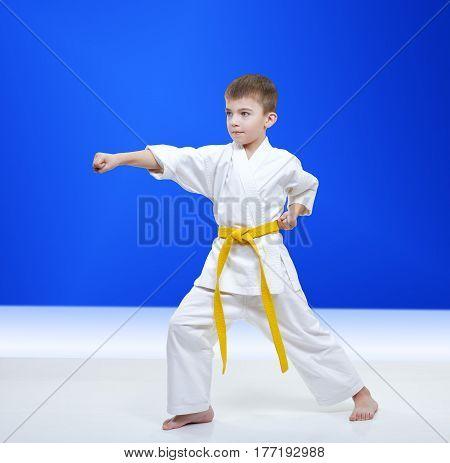 In karategi little athlete beats punch arm
