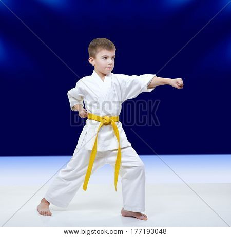 With yellow belt athlete beats punch arm