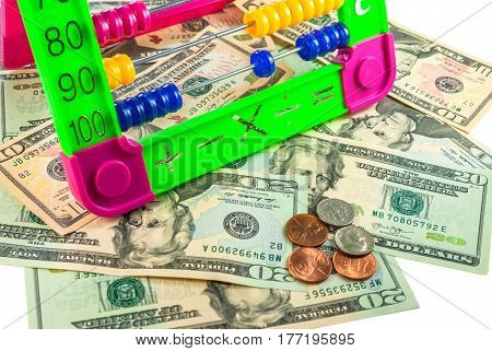 american dollars and colorful abacus on white background