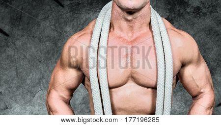 Digital composite of man Fitness Torso against dark background