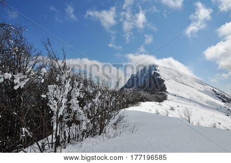 Beautiful dynamic sky above dry mountain peak Trem in Serbia. Winter landscape on mountain