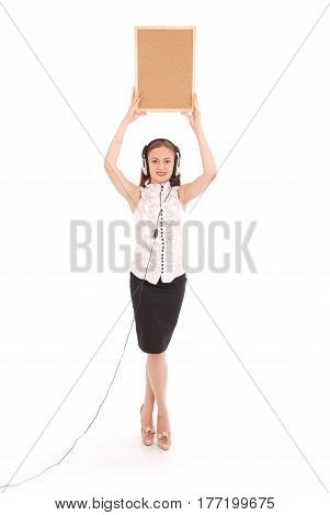Teenage girl in headphones holding cork board. Isolated on white background