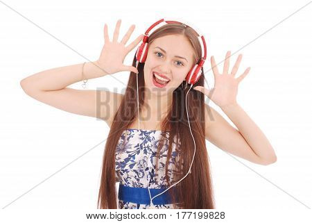 Pretty teenage girl listening music on her headphones isolated on white background
