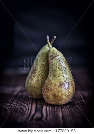 Couple Pears On Old Rustic Wooden Table Background, Dark Toned Style, Concept Vegetarian Food, Autum