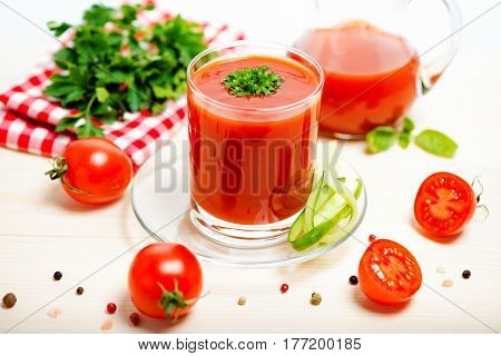 Tomato Juice In Glass, Jug With Greenery, Basil, Cutted Tomato Fruit And Dry Pepper On Light Wooden