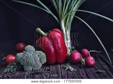 Still Life Of Red Pepper, Radish, Tomato, Green Onions And Cabbage On Old Rustic Wooden Table Backgr