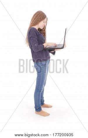 Smiling student teenage girl with laptop isolated on white