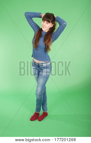 Cheerful young girl are standing against the green background