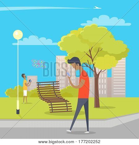 Boy looks at smartphone and walks in park where other guy plays with quadrocopter. Green tree, wooden bench near bushes, skyscrapers, streetlight in park and airplane crosses sky vector