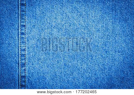 Blue Jeans Cloth With Seam Background Texture Vignette.