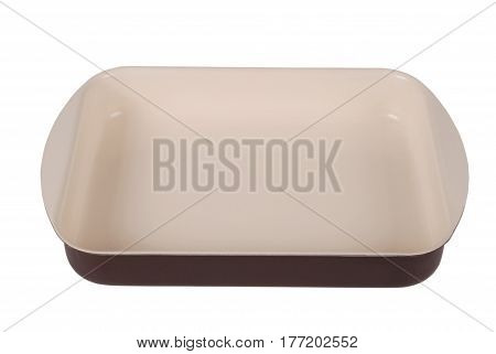 Empty brown ceramic rectangular baking dish isolated on white background with soft shadow. Clipping path