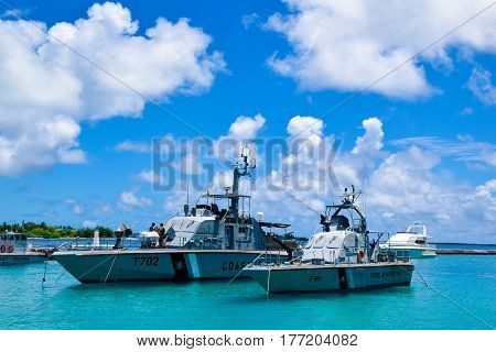 Male Maldives-October 7 2015: Fire and rescue ships are parked in the Indian ocean near the shore of Male Maldives