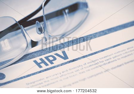 Hpv - Human Papilloma Virus - Medicine Concept with Blurred Text and Pair of Spectacles on Blue Background. Selective Focus. 3D Rendering.