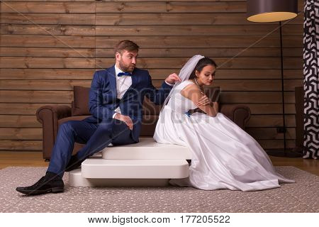 Quarrel family couple sitting on the table