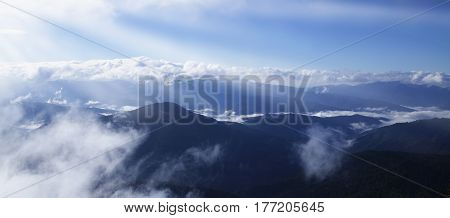 Picturesque view of the mountains that glow under sunlight. Dramatic evening scene. Location place Carpathian Mountains Ukraine Europe. Artistic picture. Beauty world.