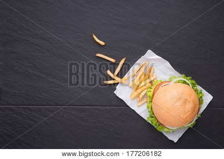 Homemade burger on table. Top view copy space horizontal