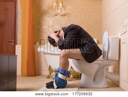 Diarrhea or constipation problem, man on toilet