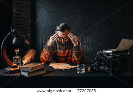 Bearded author in glasses reading his work