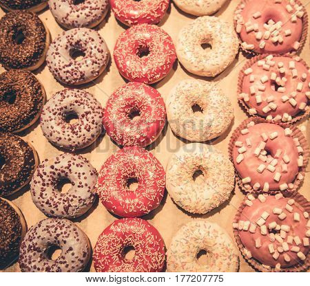At the supermarket. Top view of tasty doughnuts waiting for customers